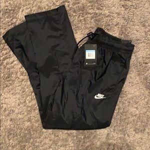 Nike men's loose fit regular length wind pants